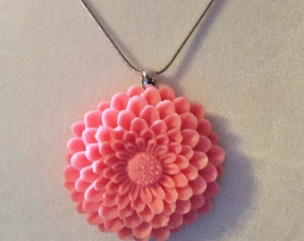 """Coral chrysanthemum resin charm strung on 18"""" silver chain"""