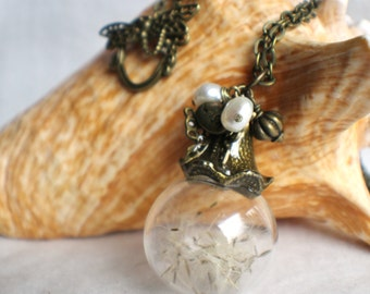 Dandelion seed glass orb on antique bronze chain hanging with freshwater pearls and butterfly