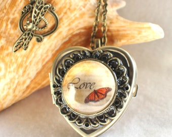 Music box locket, heart shaped locket with music box inside, in bronze or silver tone with Love and Butterfly Cabochon