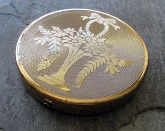vintage compact for powder makeup mirror with flower basket on front gold toned mid century 1950s with puff large round