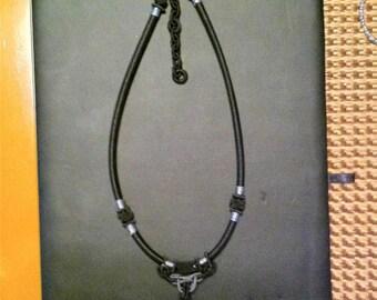 Black, gray and brown rectangle animal print pendant on adjustable black cord