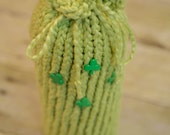 "Palest Green Wine Cozy.  12"" wine cozy made from organic cotton, with 4 green shamrock buttons sewn on."