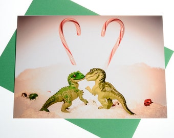 Sweetheart Xmas Card: Dinosaur Strange Love and Candy Canes, Funny Christmas Card