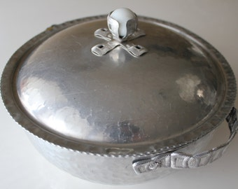 Aluminum Hammered Casserole Dish with white marble on lid.