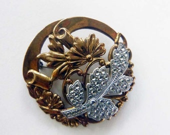 Circa 1930s art nouveau two tone lacquered brass reverse cut steel brooch