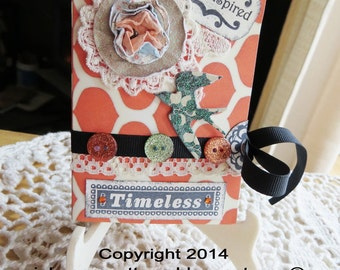 "Paper mini album with pockets, 3""x4-1/2"", ""Timeless"", orange, greens, blues, black, shabby vintage, 10 pockets, 16 photo/journal tags."