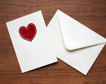 Personalised love/anniversary card with red leather heart. Handstitched, minimal, stylish. Embossed with initials of you and your loved one