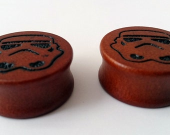 "Storm Trooper star wars gauges plugs made out of hard cherry wood sizes are in MM  12, 14, 16, 18, 20, 22, 24, 26, 28 MM 1/2"",9/16"", 5/8"" cc"