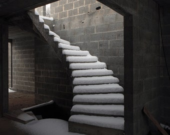Snow on stairs of an abandoned unfinished house near Deauville, France