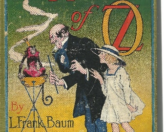 The magic of oz l frank baum book cover and illustrations