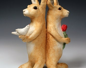 2 ceramic hares, tan and white ceramic hare sculpture, original fired clay animal sculptures carrying symbols of peace and love