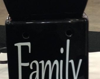 "Tart warmer proudly says ""Family"" on the front.  It comes with two free packages of soy breakaway tarts."