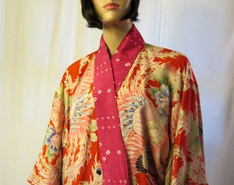 Early 20th Century-Japanese Printed Kimono in Hues of Pink, Red, and Magenta