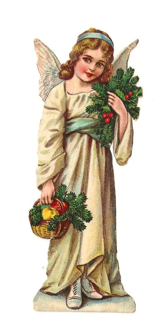 Engel mit Mistel-Zweig und Obstkorb. Antike Die Ausschneiden Figur 12 cm. Deutschland. 1920 Vintage. Weihnachten. Ende des Jahres.