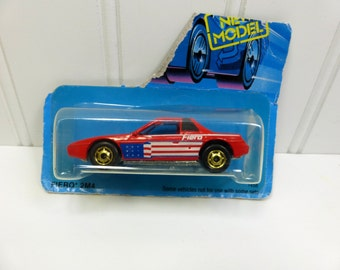 Hot Wheels '84 Fiero 2M4 in Red with Stars and Stripe, Hot Ones Pontiac Fiero GHO
