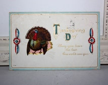 """Vintage Thanksgiving Postcard Embossed with a red, white and blue ribbon """"Thanksgiving Day"""" 1915"""