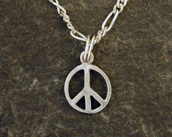 Sterling Silver Tiny Peace Sign Pendant on a Sterling Silver Chain
