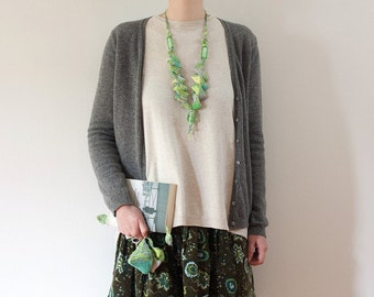 Long geometric necklace, knitted statement asymmetric jewelry with silver foil glass beads, green gray yellow, OOAK