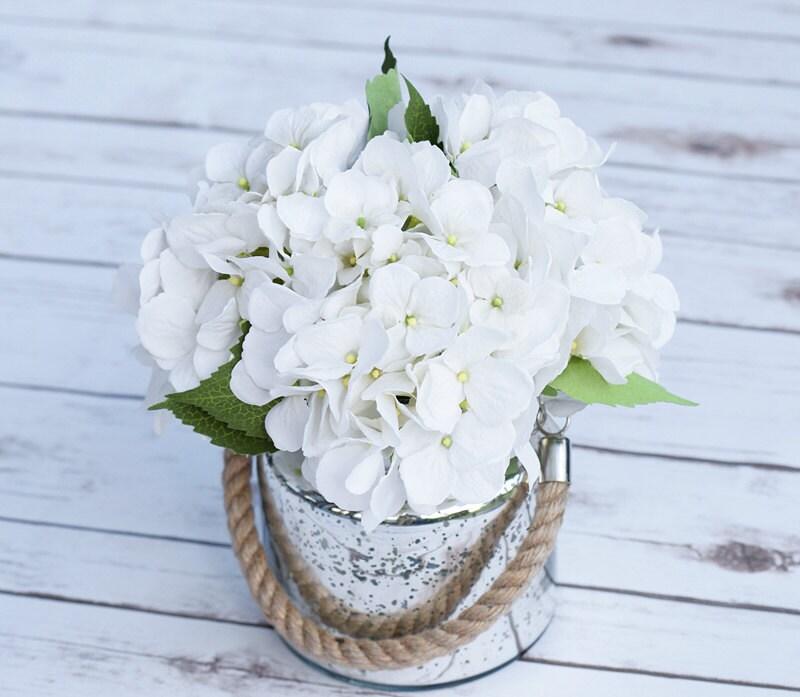 Silk off white hydrangeas and greens arrangement centerpiece