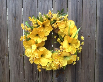 Burlap wreath with bright, golden flowers