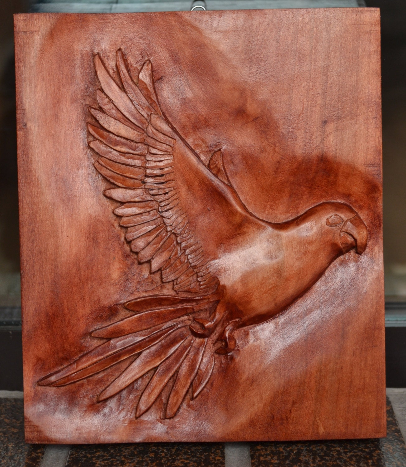 Parrot hand carved sculpture relief on limewood board bird