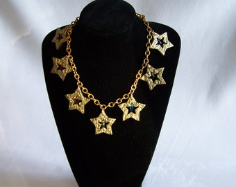Necklace 9 golden  stars with rainbow beads on a gold chain