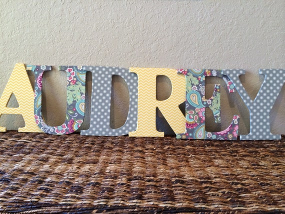 wooden letters covered in fabric Wooden letter with a marvel fabric front and spider-man and  using the paint  brush cover the area you are going to decoupage with pva.