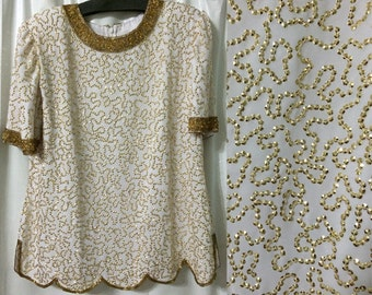 White and gold sequin blouse