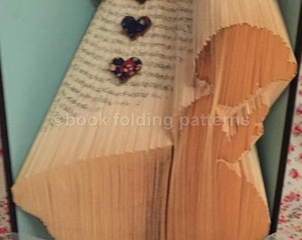 Little girl praying book folding pattern