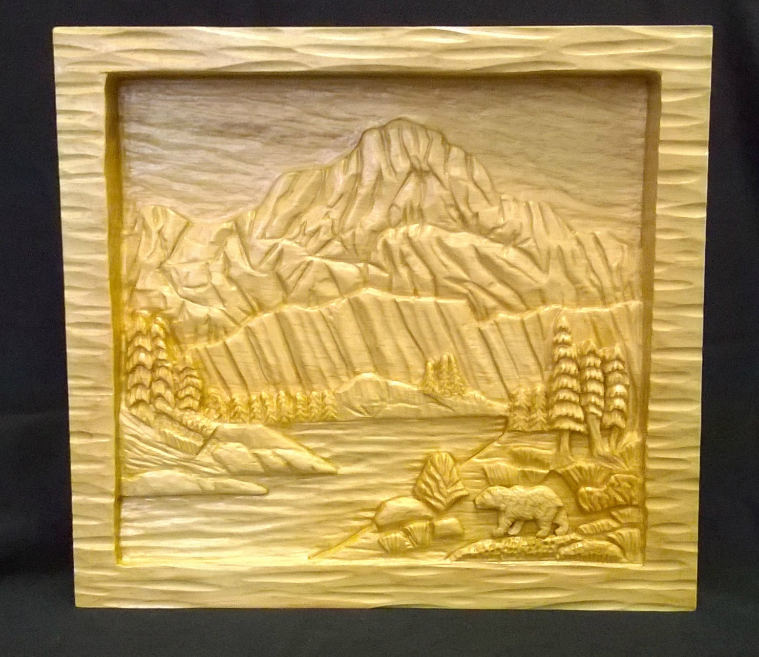 Mountain lake relief carving with bear on by idahowoodcarvings