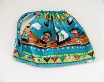 Child bag in blue cotton fabric with cowboys and western