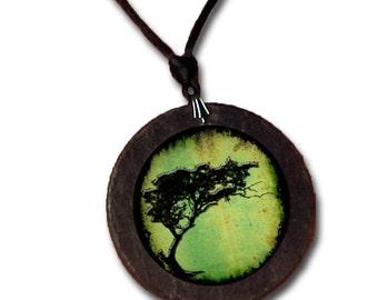 Slate necklace featuring an Acacia Tortillis Tree on green background