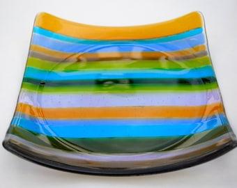Multicolored fused glass dish.