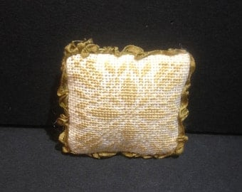 Miniature pillow with silk embroidery