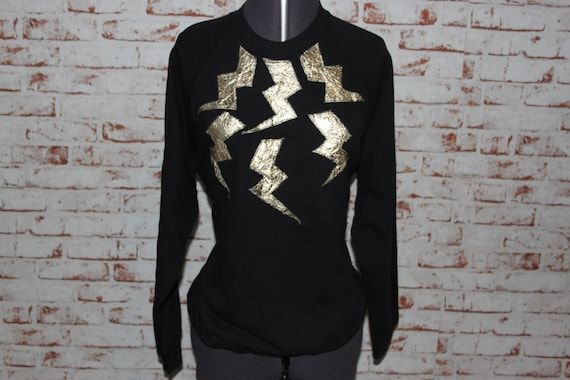 Black Jumper, Gold Applique Thunder Bolts. Size - Medium (10-12)