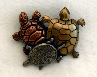 Tri Color Metal Trio of Turtles Brooch from sometime before 1995