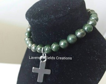 Green pyrite stretch beaded bracelet with cross charm and rhinestone accents (201753B)