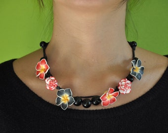 Flower necklace and black and Red Roses