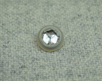 Crystal plastic button