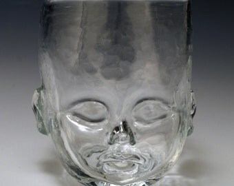 The unique Baby Head Cup, a hand made glass tumbler designed and created by Oliver Doriss.