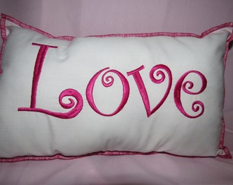 LOVE is in the air.  Display your festive mood with this throw pillow.