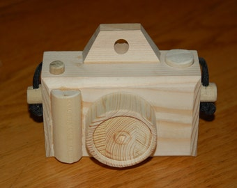 This is a hand made wooden camera model scaled down for children.