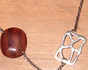Silver necklace & tropical wood.