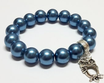 Owl in blue bracelet