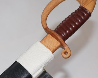 Toy wooden saber with leather sheath