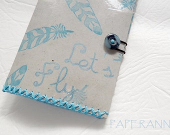 Paper passport cover: Blue feathers.