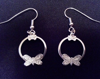 Earrings silver with butterfly pattern.