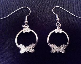 Earrings silver with butterfly pattern.