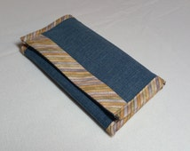 Denim wallet.. 2 zipper pockets for loose change,10 credit card slots,5 open slots for your money or receipts.