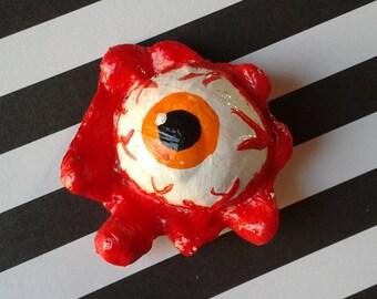 Orange eyeball pin